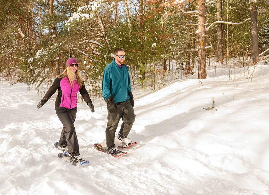 Couple snowshoeing in forest