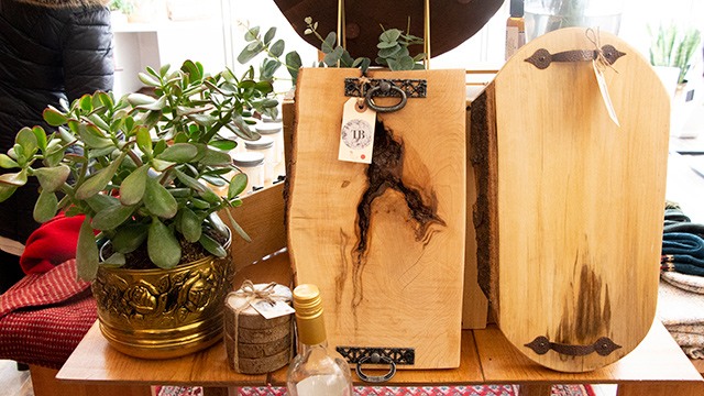 Handmade charcuterie boards on display at store