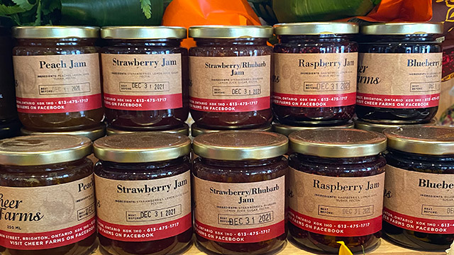 Rows of jams on display at farmers market