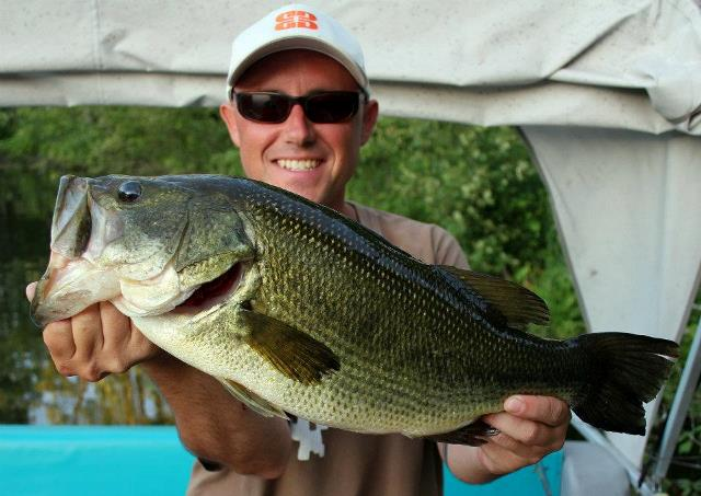 Man holding large bass on Rice Lake, Ontario