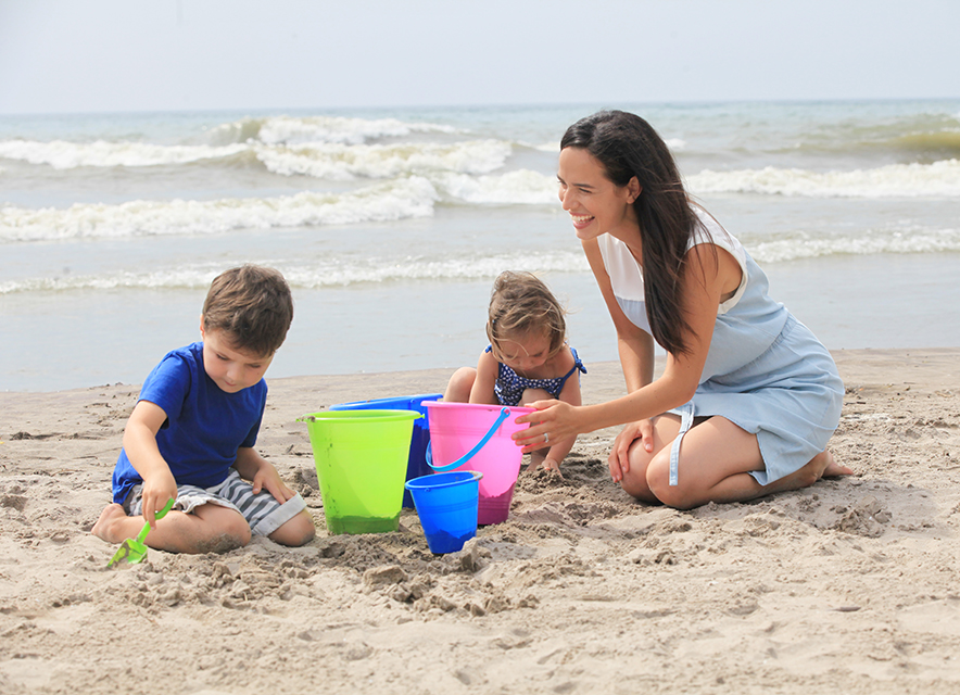 Mother with children on the beach