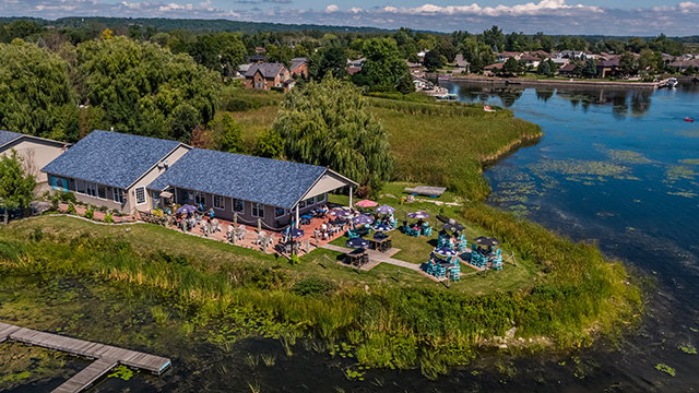 Drone image of restaurant with patio at water's edge