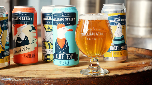 Cans of craft beer with beer in glass