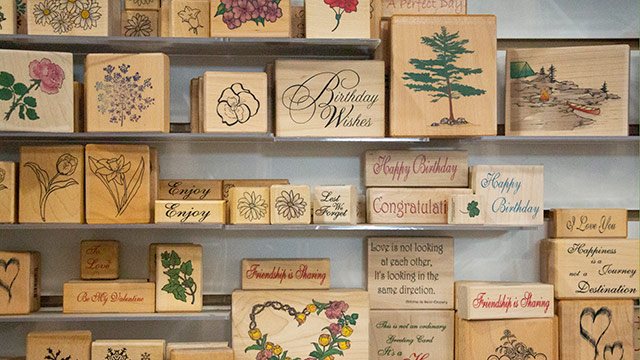 Rows of rubber stamps and supplies