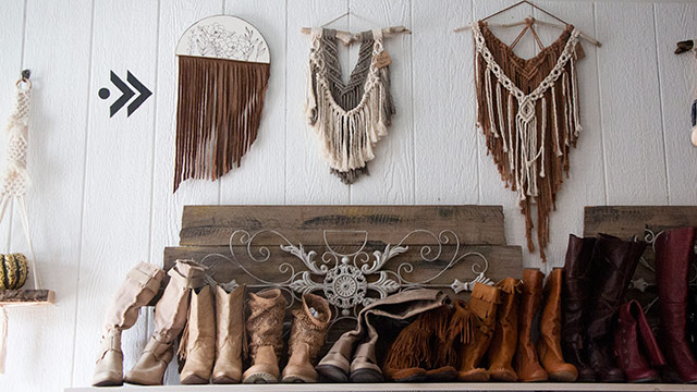 wall hangings and boots on shelf in retail store