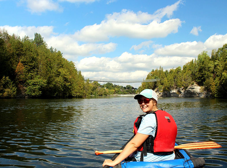 Woman paddling near Ranney Gorge Suspension Bridge