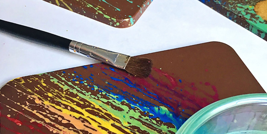 Chocolate with paint brush and food paint splattered on the chocolate