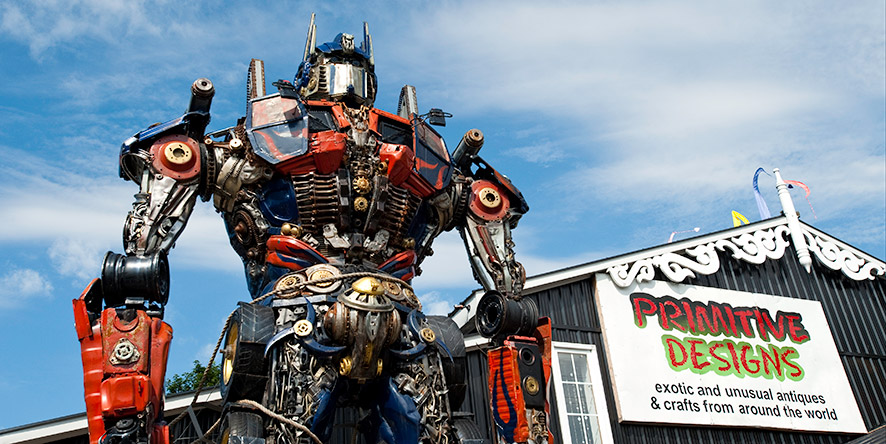 Giant robot in front of Primitive Designs