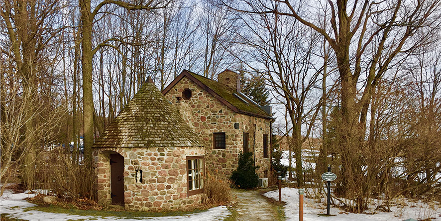 Exterior of stone cottage in winter at inn and spa