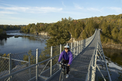 cyclist on Ranney Gorge Suspension Bridge