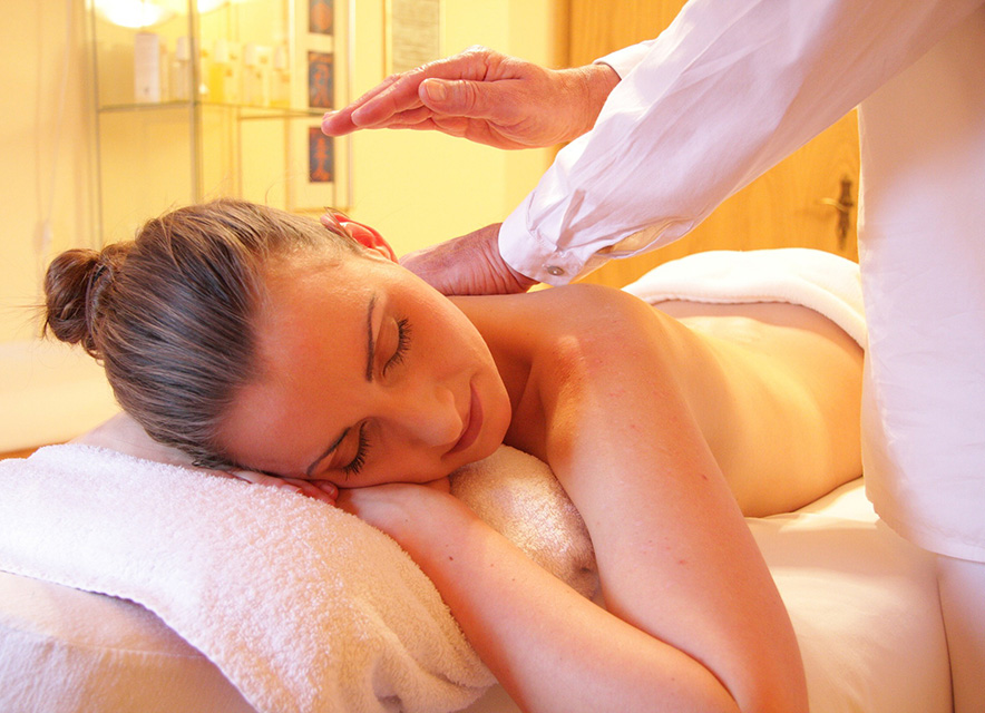 Woman on massage table getting treatment at day spa