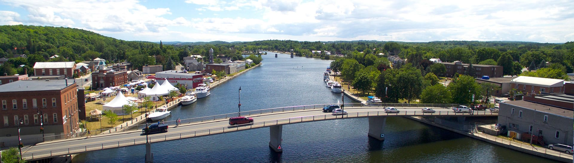 Drone view of bridge crossing Trent River in Campbellford with cars driving over