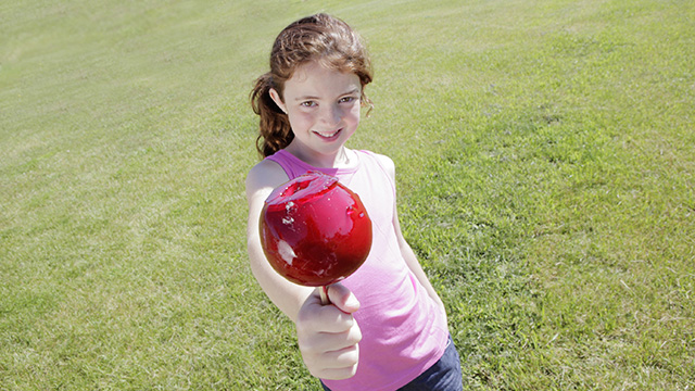Girl holding candy apple