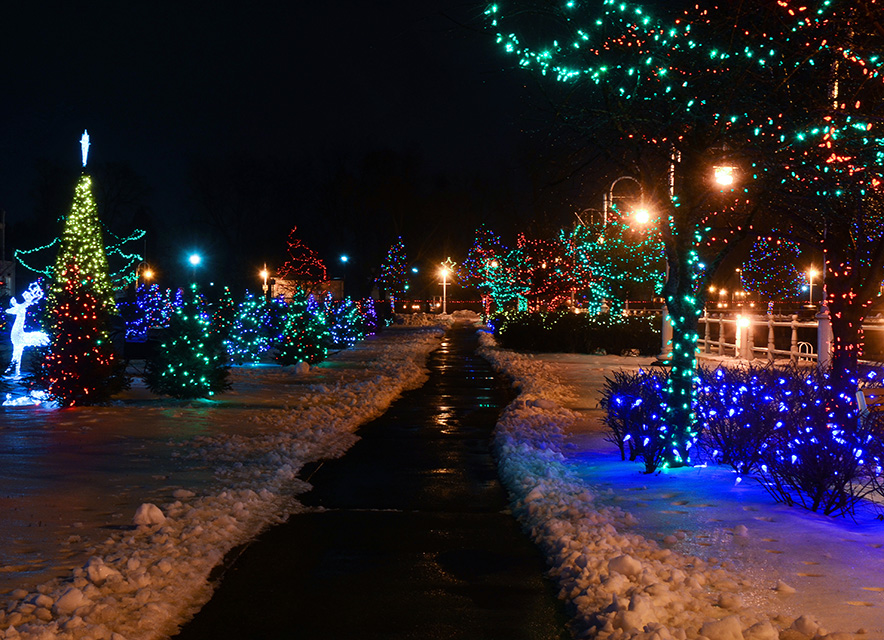 Christmas light display near harbour with snow and shovelled path