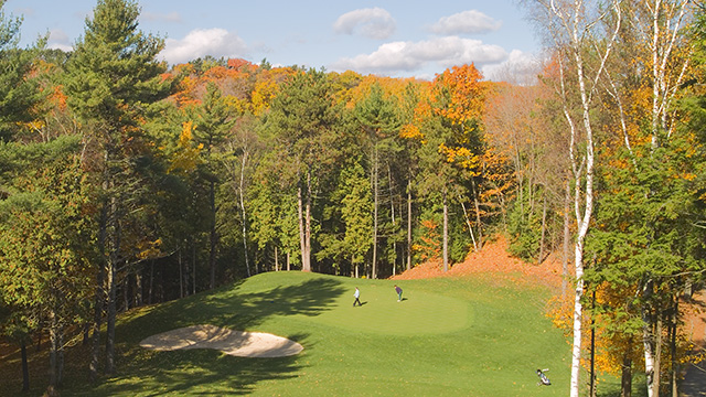 Golfers on course in fall