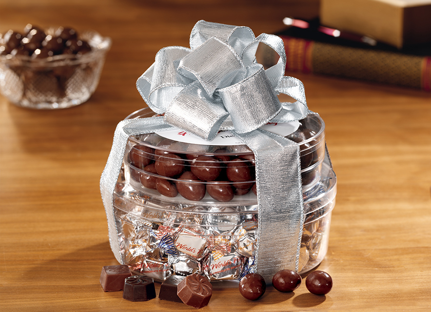 Gift package of different chocolates tied with bow