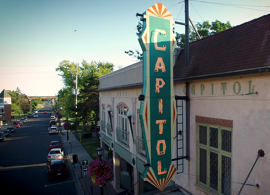 Exterior  in summer of Capitol Theatre with marquis sign