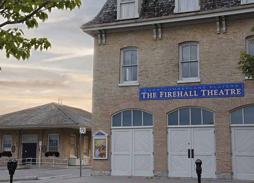Dusk shot of Firehall Theatre exterior with tree in foreground
