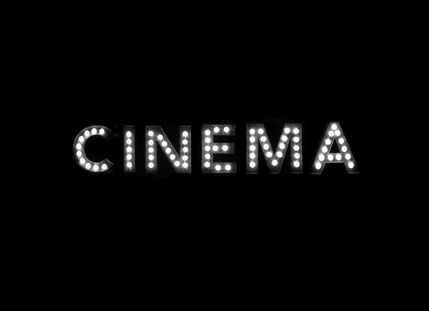 the word cinema in lights on black background