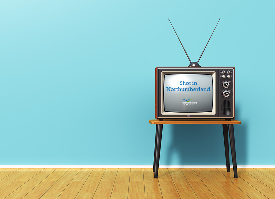 Vintage television on wood floor and blue background