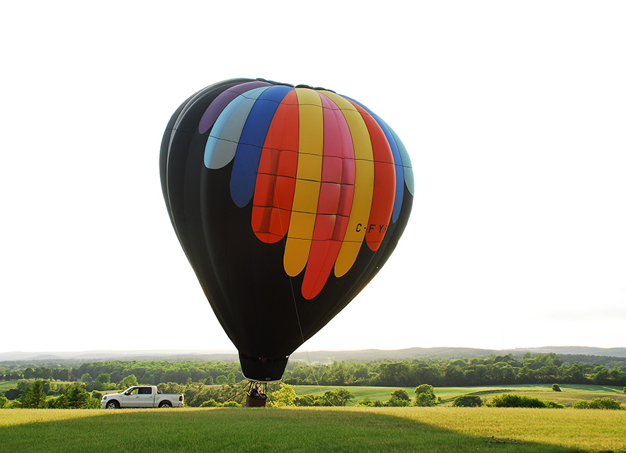 Inflated Balloon on rolling green hill