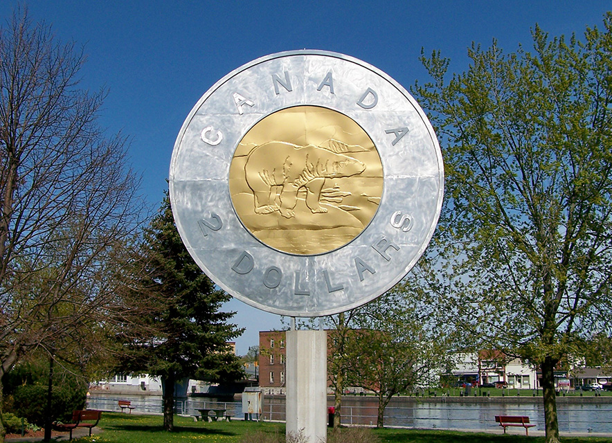 Giant toonie monument with blue sky behind in spring