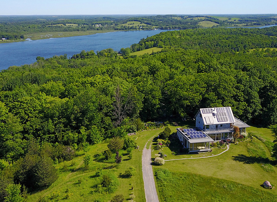 Aerial view of Harmony Dawn Retreat in summer with Rice Lake in background