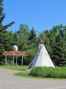 Indian craft sign beside teepee