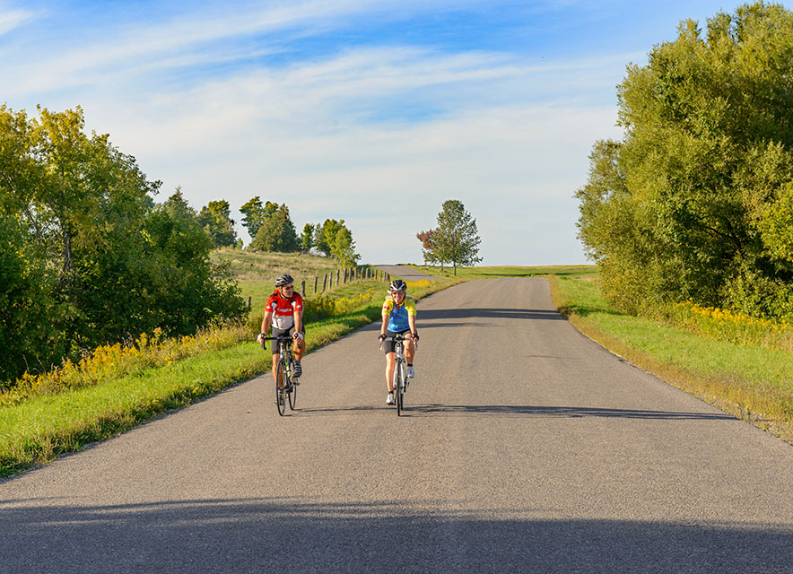 Couple cycling on country road