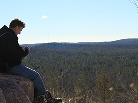Man sitting on boulder at Lookout Mountain