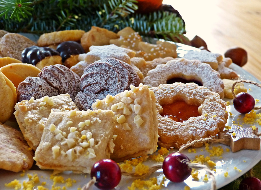 Christmas cookie on a tray with evergreen decorations behind