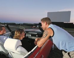 man and woman in car at the drive in