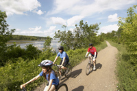Three people cycling the Trans Canada Trail at Hastings