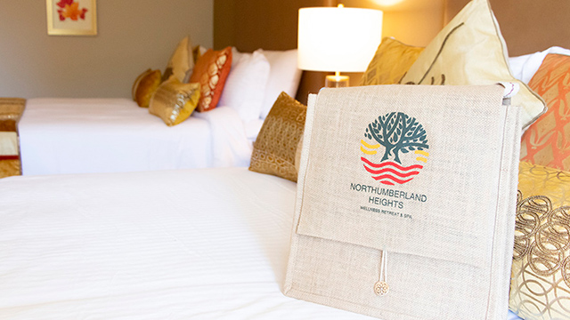 branded bag on beds in room at Northumberland Heights Wellness Retreat