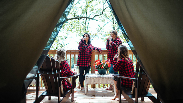 Group of women at on patio of glamping tent at Whispering Springs