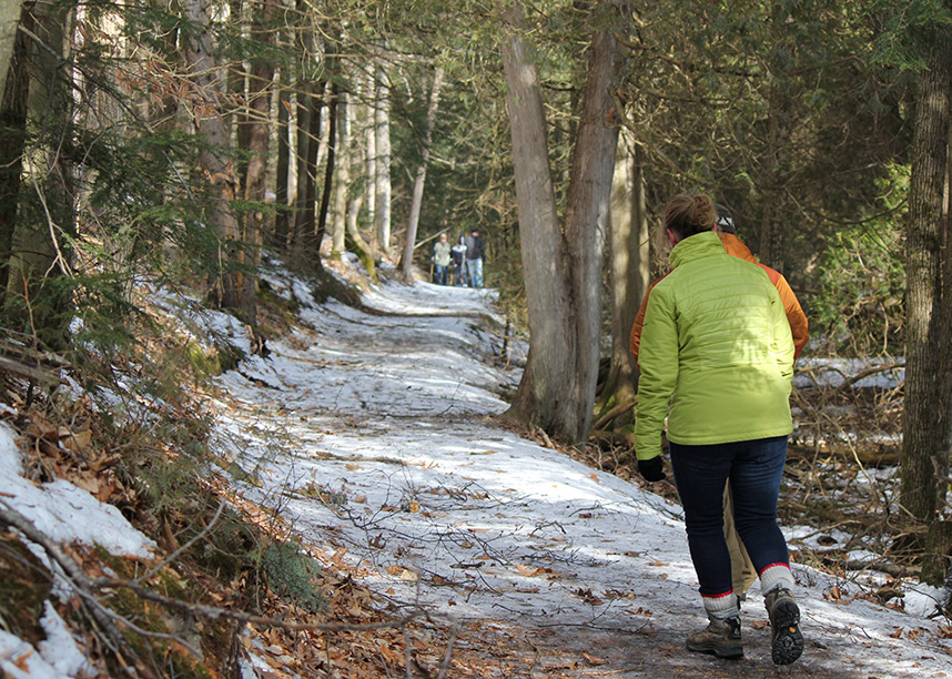 Person hiking along snowy trail